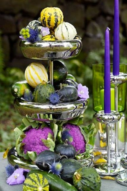 a three-tier silver stand with gourds, pumpkins and cabbage, thistles for an accent