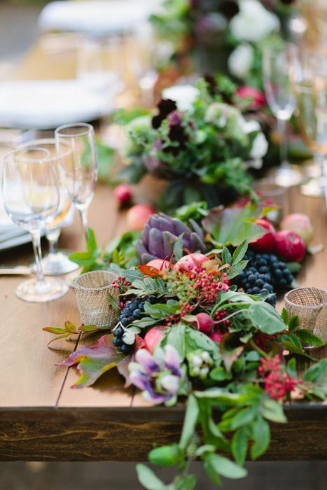 farm-inspired table runner with greenery, veggies and berries for a rustic wedding