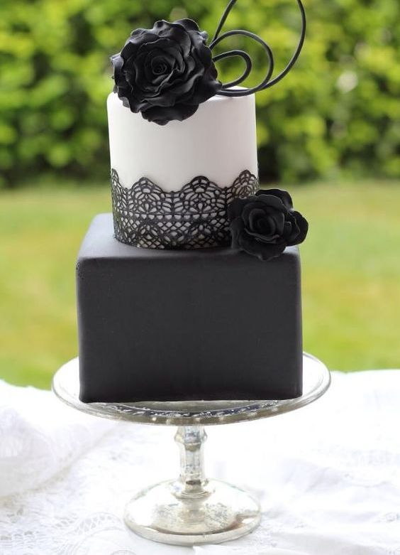 matte black and white modern cake with black lace and black cream roses decor