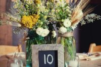 30 jars with wildflowers, candles and a framed table number for a cute rustic tablescape