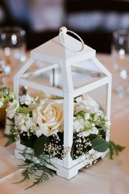 31 chic lantern wedding centerpieces youll like weddingomania a white lantern with fresh neutral blooms can become a great base for any wedding centerpiece junglespirit Images
