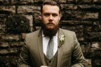31 brown grey three piece wedding suit, a white shirt, a grey tweed tie and a floral boutonniere