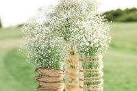 31 twine and burlap wrapped glasses with baby's breath look simple and very cute
