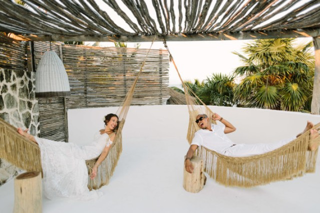 Hammock swinging was one of the parts of the wedding, and the couple and guests had fun