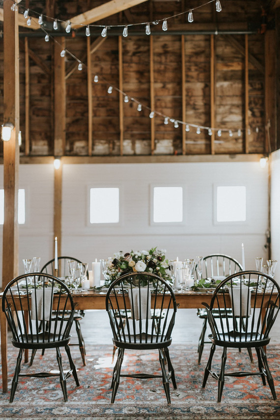 The wedding tablescape was rustic and vintage, look at these chic black chairs