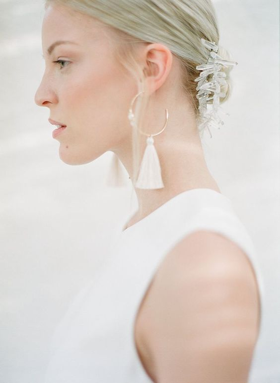 a quartz bridal headpiece and modern rhinestone and white tassel earrings