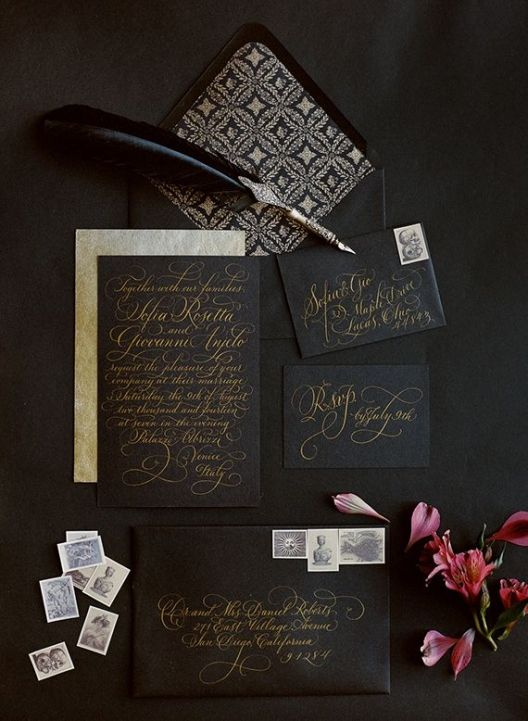 black wedding stationery with gorgeous gold calligraphy and beautiful printed lining