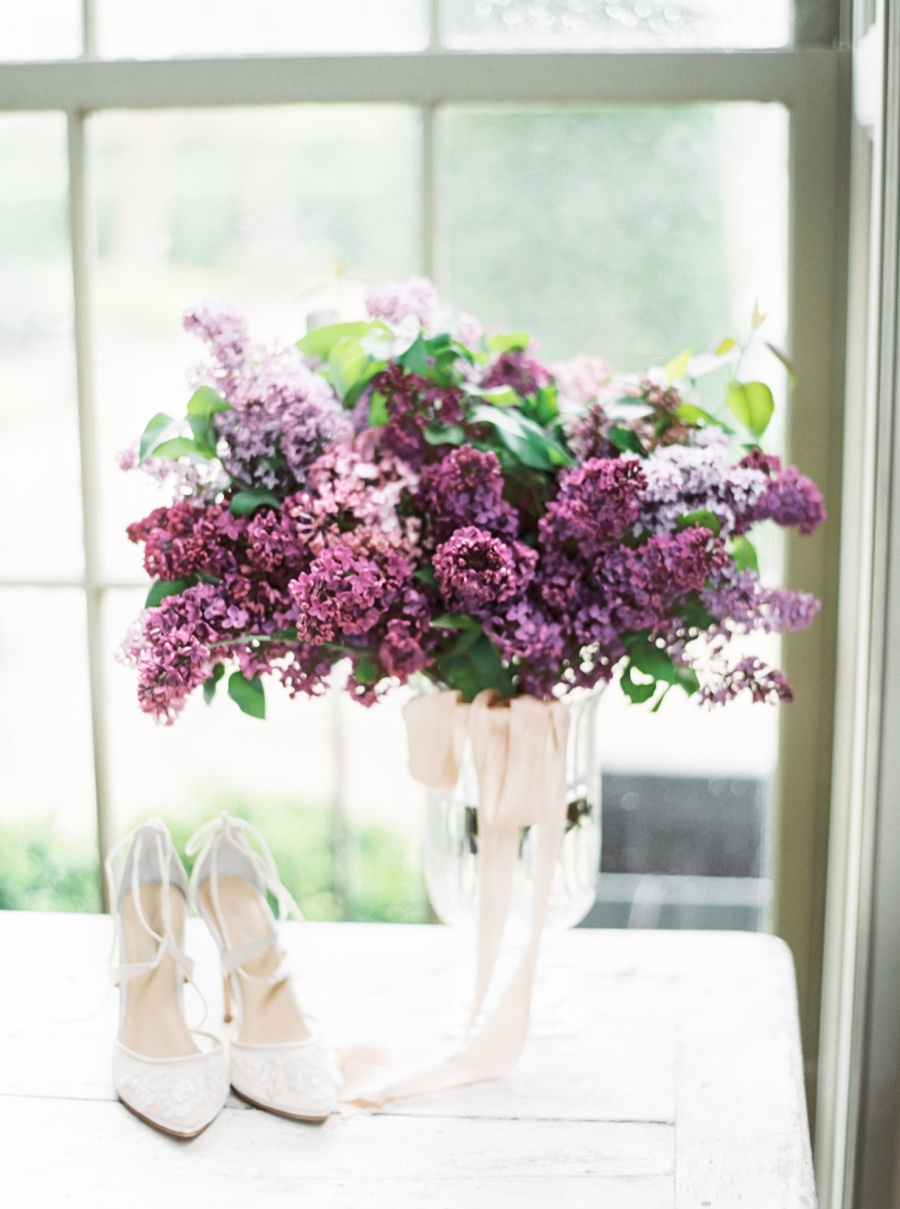 Sheer lace wedding shoes is a romantic choice to pair with a glitter gown, and the bridal bouquet was of lilac