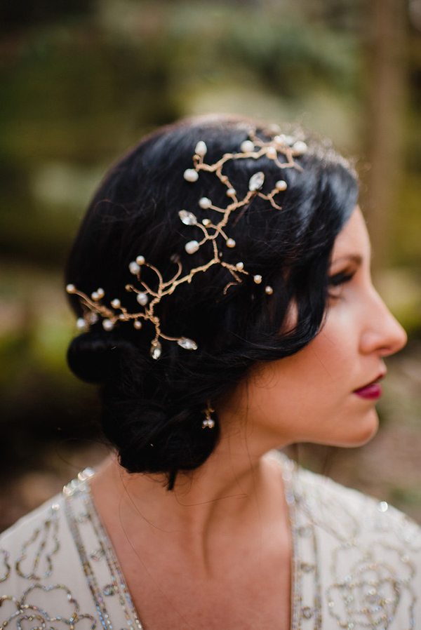 The bride was wearing a side updo with a gold and crystal headband