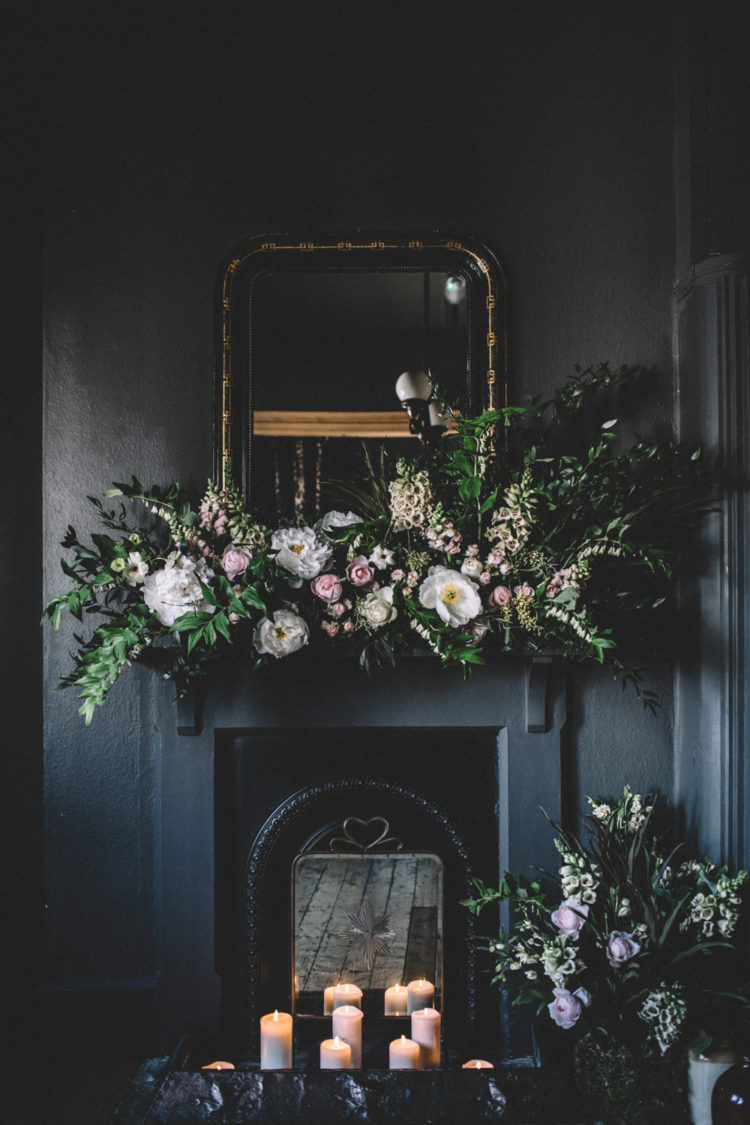 The fireplace was decorated with white and blush blooms and lush greenery