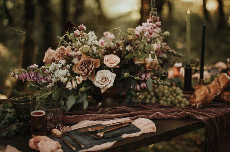 The floral centerpiece was done in blush, purple, green and different muted shades for a chic look