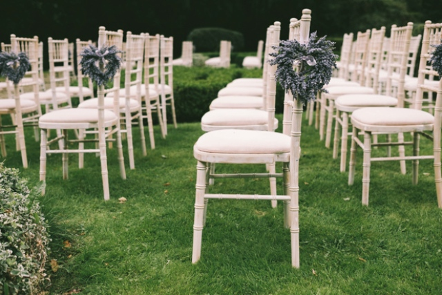 The wedding aisle was decorated with lavender hearts