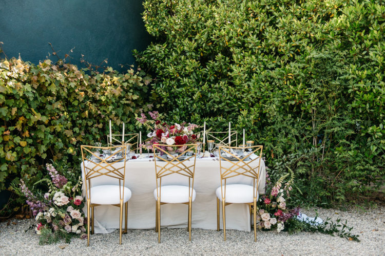 The wedding tablescape was full of bold colors, gold and glam, and look at those chairs - they are so art deco