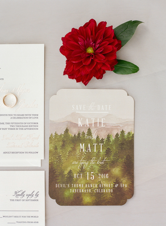 The wedidng invites reflected the location - Colorado mountains and forests