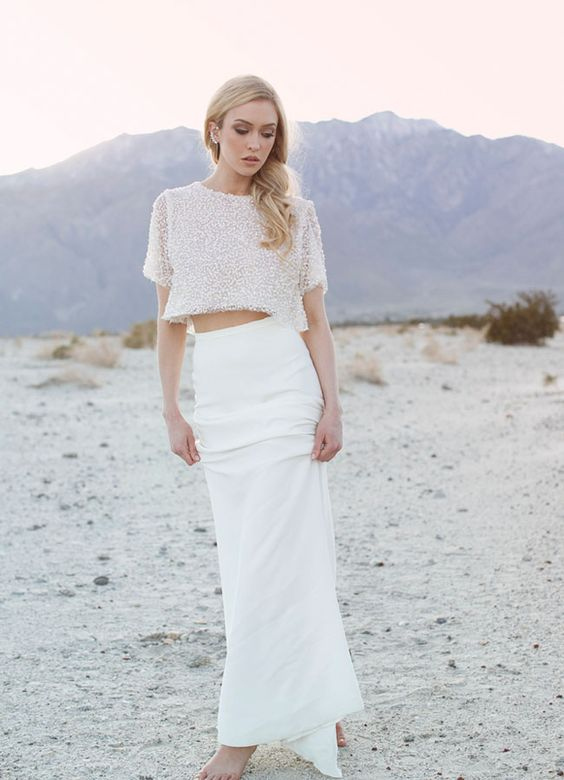 a fitting plain skirt and a sparkling short sleeve crop top create a chic modern bridal look