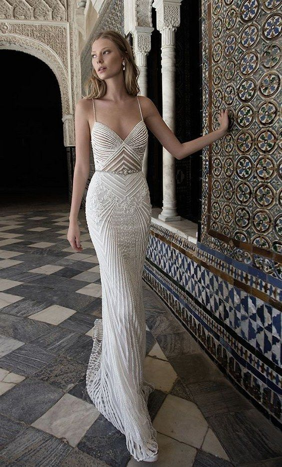 a heavily beaded spaghetti strap sheath wedidng dress