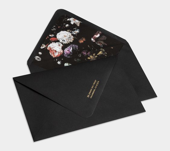 black envelopes with moody floral lining are right what you need for a dark-inspired wedding