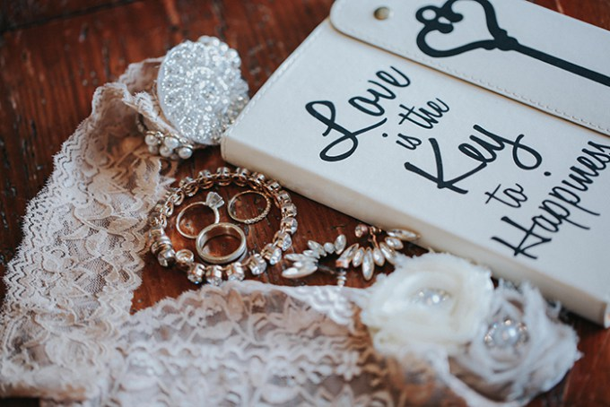 Exquisite bridal jewelry and her lace sash with a jeweled brooch