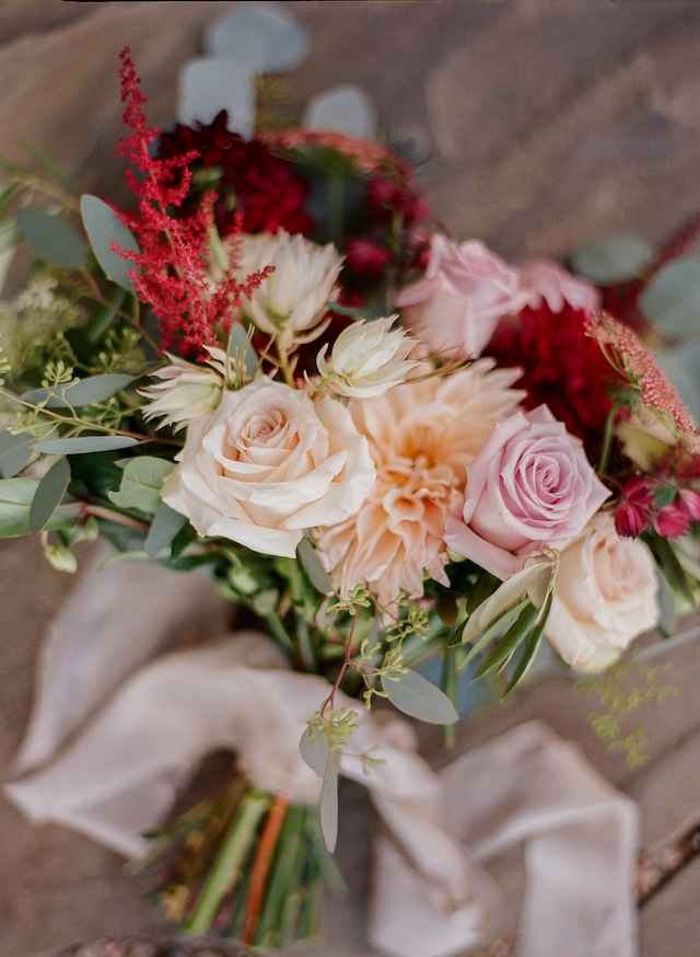 The bouquet was tender and fall-like, with blush, rose, peachy and burgundy blooms