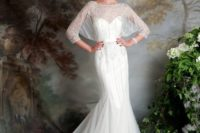 04 a mermaid wedding dress with a sweetheart illusion neckline, half sleeves and beading