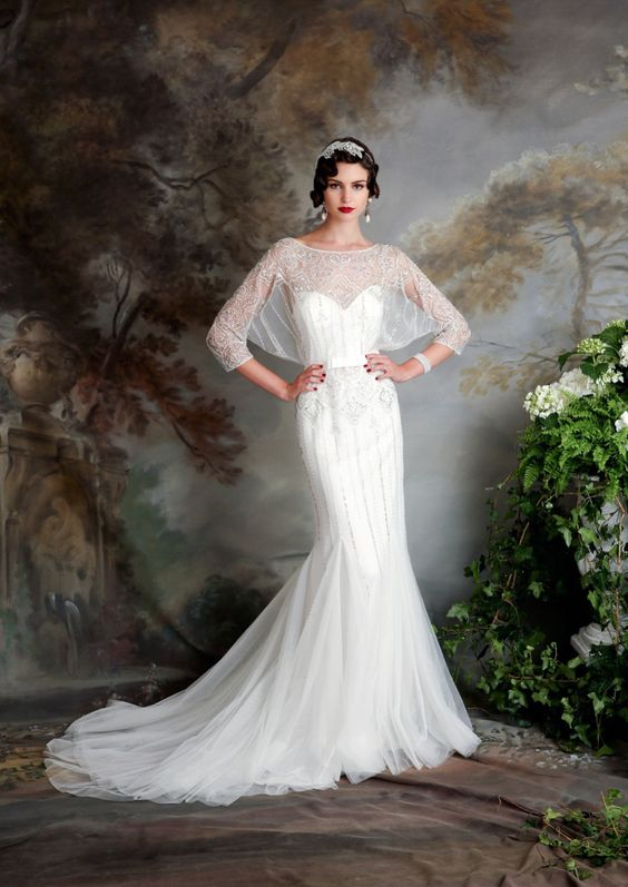 a mermaid wedding dress with a sweetheart illusion neckline, half sleeves and beading