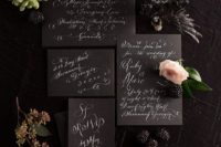 04 black wedding stationery with white calligraphy will fit many wedding themes and styles