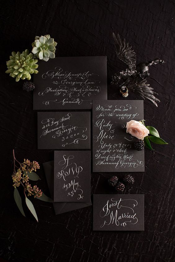 black wedding stationery with white calligraphy will fit many wedding themes and styles