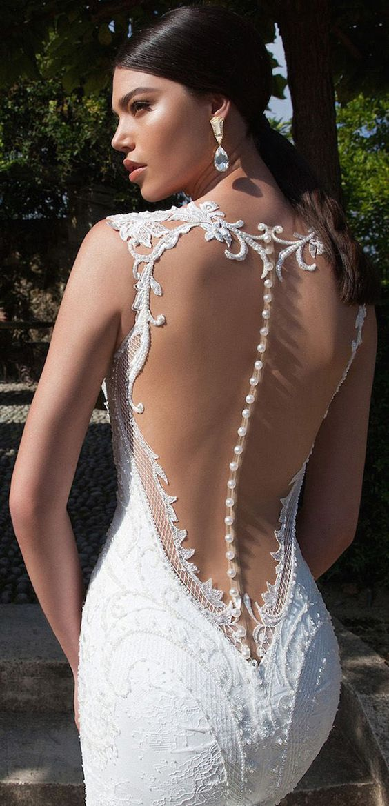 mermaid wedding dress with an illusion back and a row of buttons to highlight it