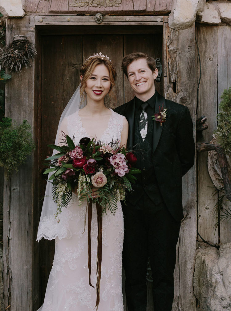 the groom's look inspired by the magic attire in the book, with a printed suit and an unusual tie