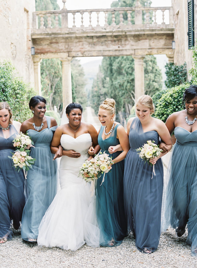 The bridesmaids were wearing different shades of blue, with greyish touches