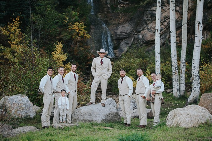 The groomsmen were wearing same suits minus jackets and looked simple and elegant