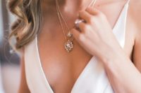 05 a gorgeous crystal drop layered necklace will fit a plunging neckline wedding dress