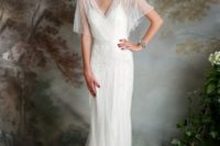 05 an airy and flowing wedding dress with a deep V neckline, flowy short sleeves, some matching beading