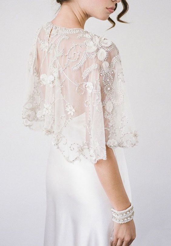 embellished lace applique capelet for a sleek modern wedding dress