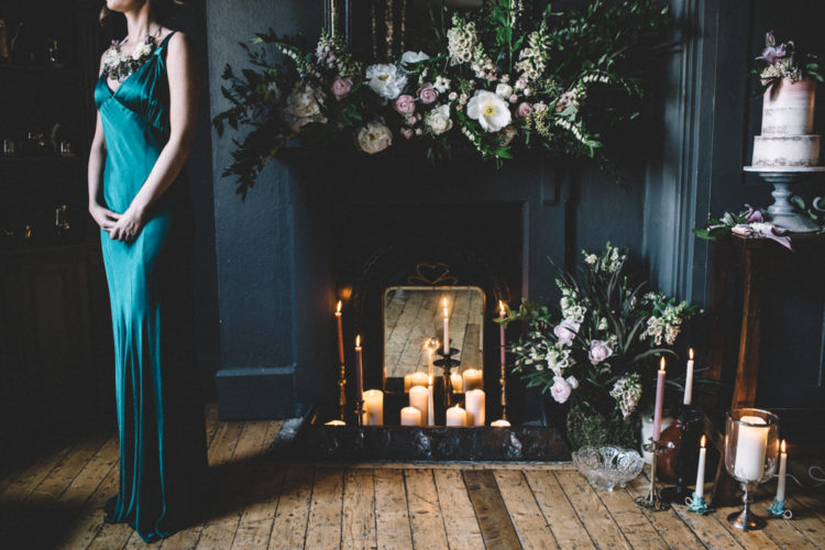 The bridesmaid was rocking a bold emerald dress with straps and a floral necklace