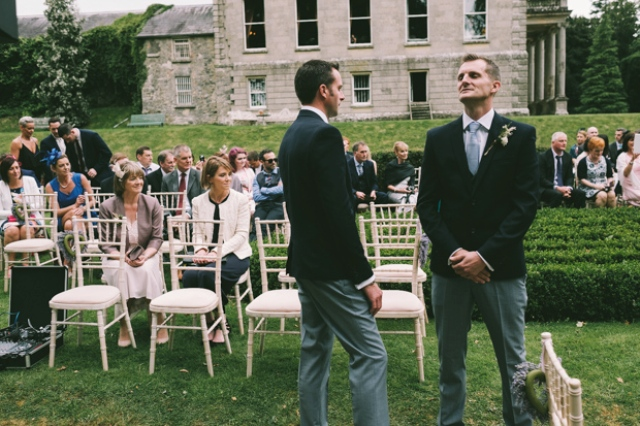 The groom and groomsmen were wearing three-piece suits with pants, waistcoats and black jackets