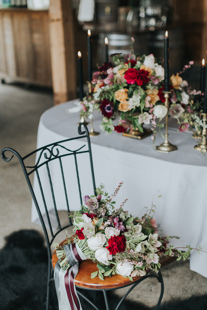 The wedding bouquet was done in neutrals, with pink and purple blooms