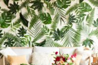 06 a wedding lounge with a tropical leaf wall – real leaves are attached to the wall