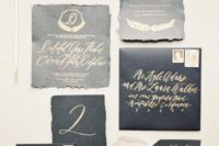 06 black textural wedding stationery with gold calligraphy and a raw edge