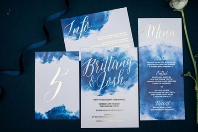 bold watercolor indigo wedding invites with silver calligraphy and whites