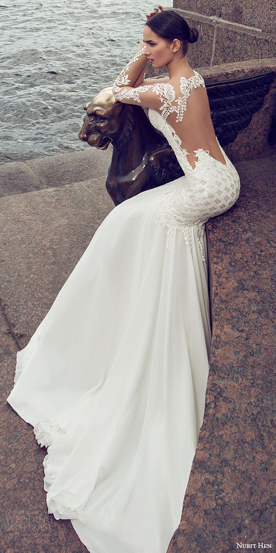 embellished mermaid wedding dress with illusion sleeves and an illusion back for a sexy look