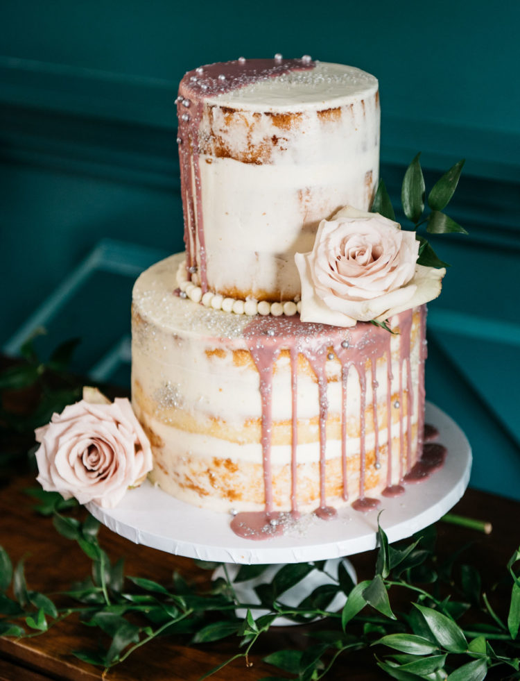 The first wedding cake with pink dripping, edible pearls and blush roses