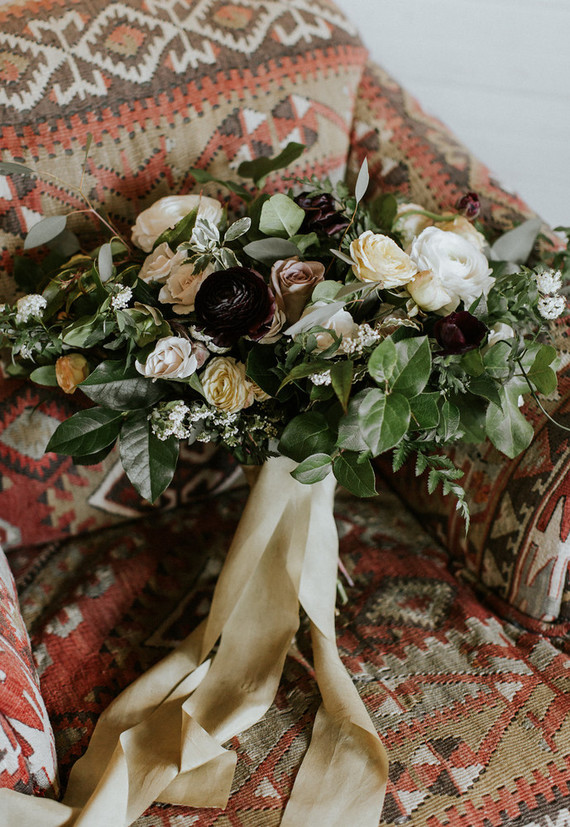The wedding bouquet was kush and gorgeous, with very dark blooms as accents