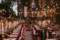 07 a wedding reception with burgundy touches and lots of lights in the backyard of a castle