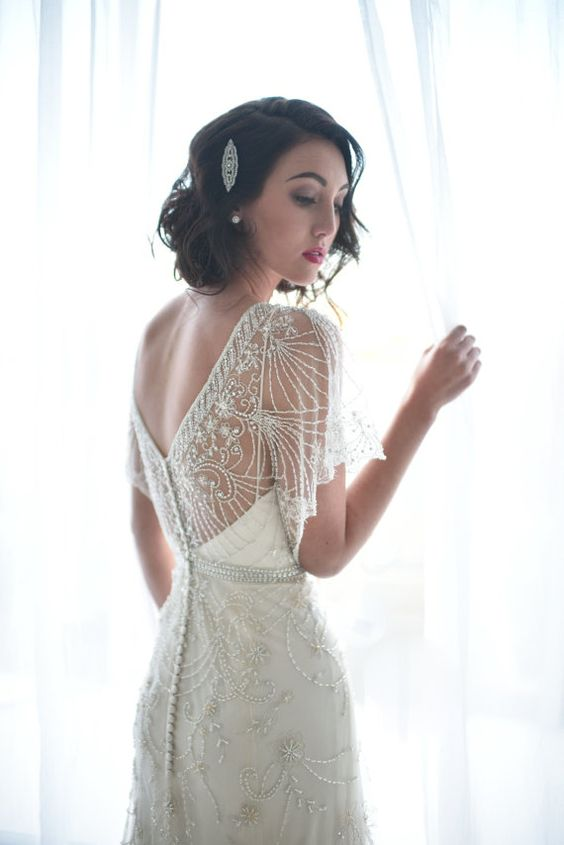 28 sparkling art deco wedding dresses weddingomania an embroidered and beaded wedding dress with a v cut on the back a row junglespirit Choice Image