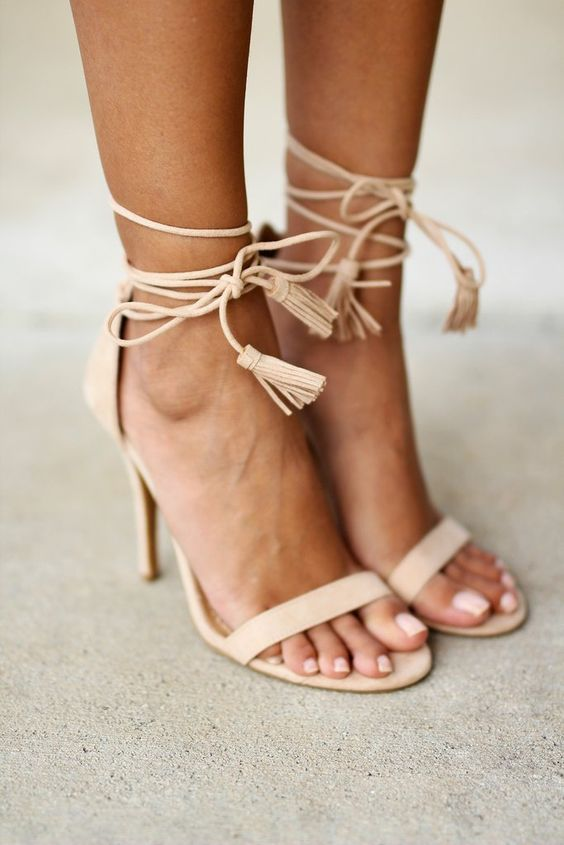 nude strappy heels with tassels are a timeless and edgy choice for the bride