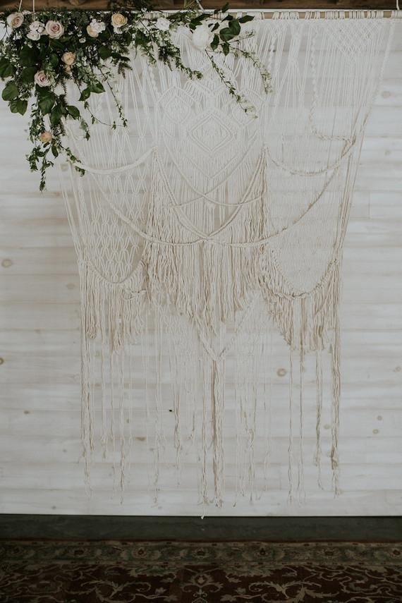 A macrame wedding backdrop is a nice idea for a boho chic wedding