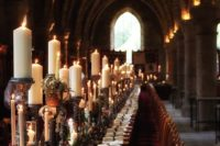 08 Harry Potter wedding tablescape with a candle table runner, air plants and greenery