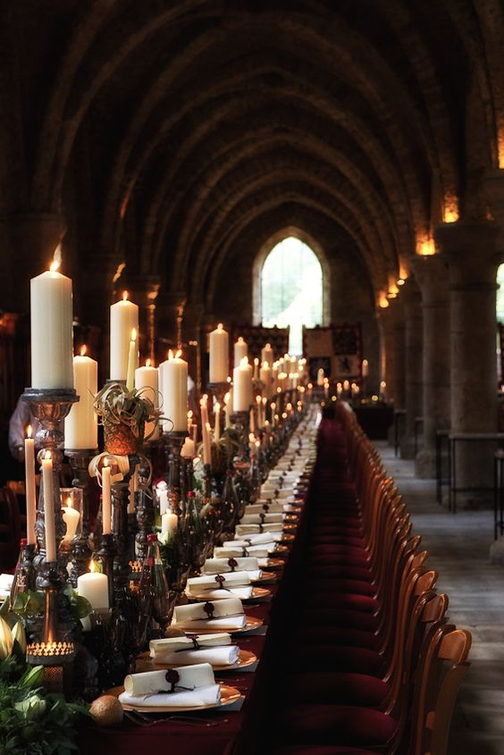 Harry Potter wedding tablescape with a candle table runner, air plants and greenery