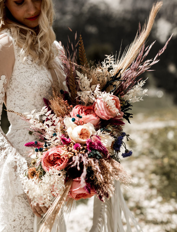 The wedding bouquet was lush and textural, with wheat, pink blooms and herbs